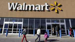 In this Feb. 20, 2012, file photo, customers walk into and out of a Wal-Mart store in Methuen, Mass.