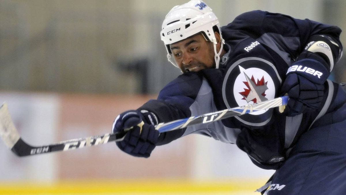 Winnipeg Jets player Dustin Byfuglien takes a shot during the NHL team's training camp in Winnipeg, September 17, 2011. REUTERS/Fred Greenslade