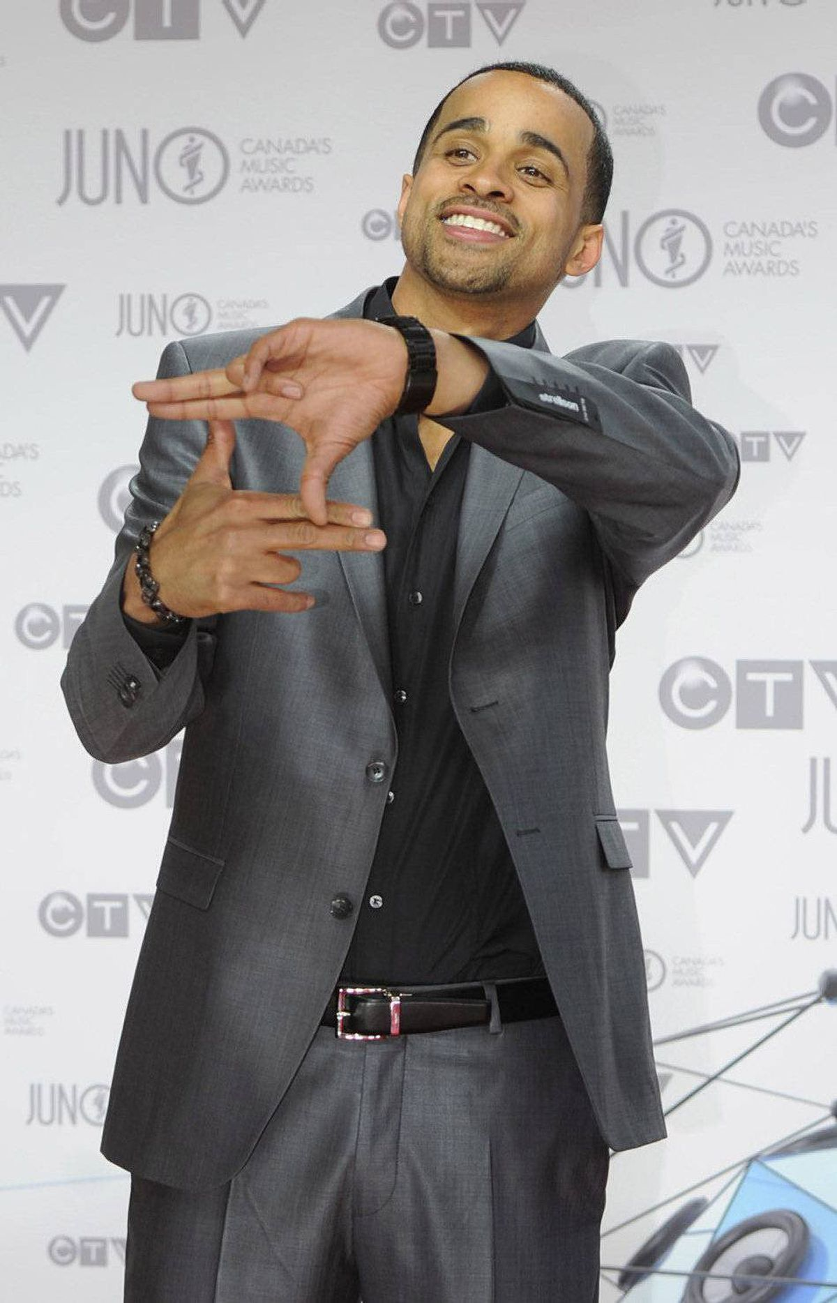 Jrdn poses for photographers as he arrives on the red carpet at the Juno Awards in Ottawa, Sunday April 1, 2012.