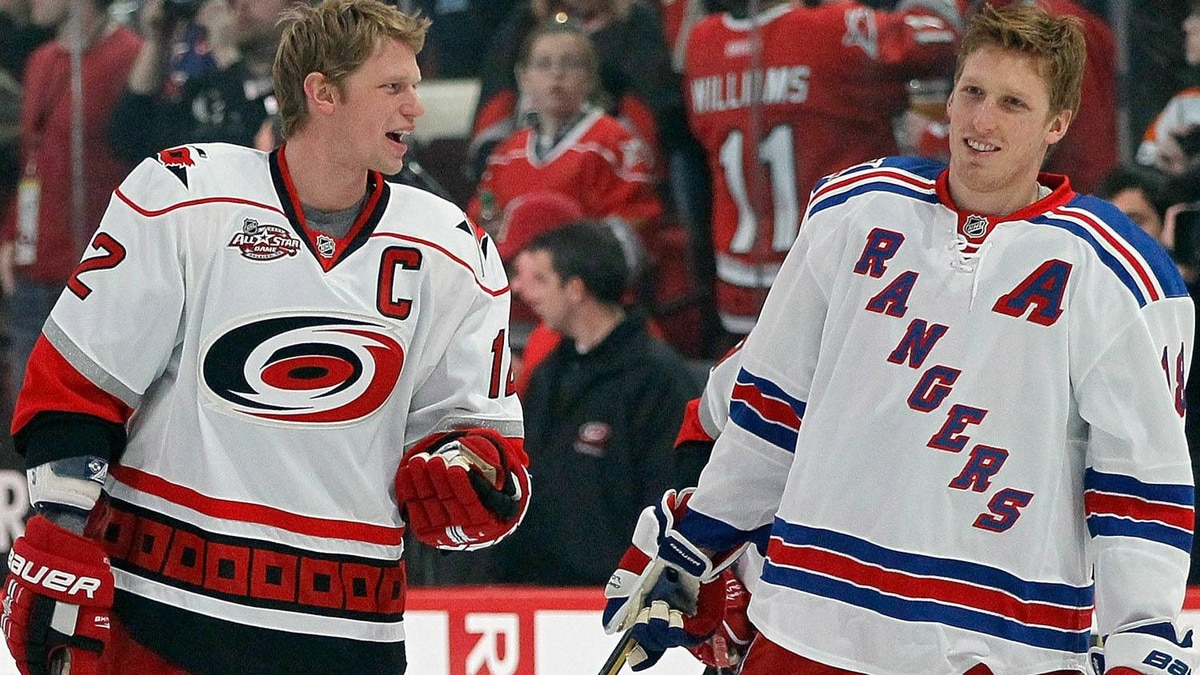 Eric Staal #12 of the Carolina Hurricanes and Marc Staal #18 of the New York Rangers skate on the ice before the Honda NHL SuperSkills competition part of 2011 NHL All-Star Weekend at the RBC Center on January 29, 2011 in Raleigh, North Carolina. (Photo by Kevin C. Cox/Getty Images)