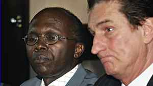 Léon Mugesera, left, and lawyer Guy Bertrand ponder questions of a news conference on June 29, 2005 in Quebec City.