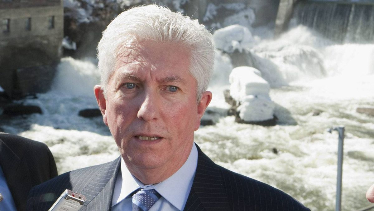 Bloc quebecois Leader Gilles Duceppe, right, responds to media questions while standing near the Hyatt falls following a nomination meeting Sunday, April 3, 2011, in Sherbrooke Que.