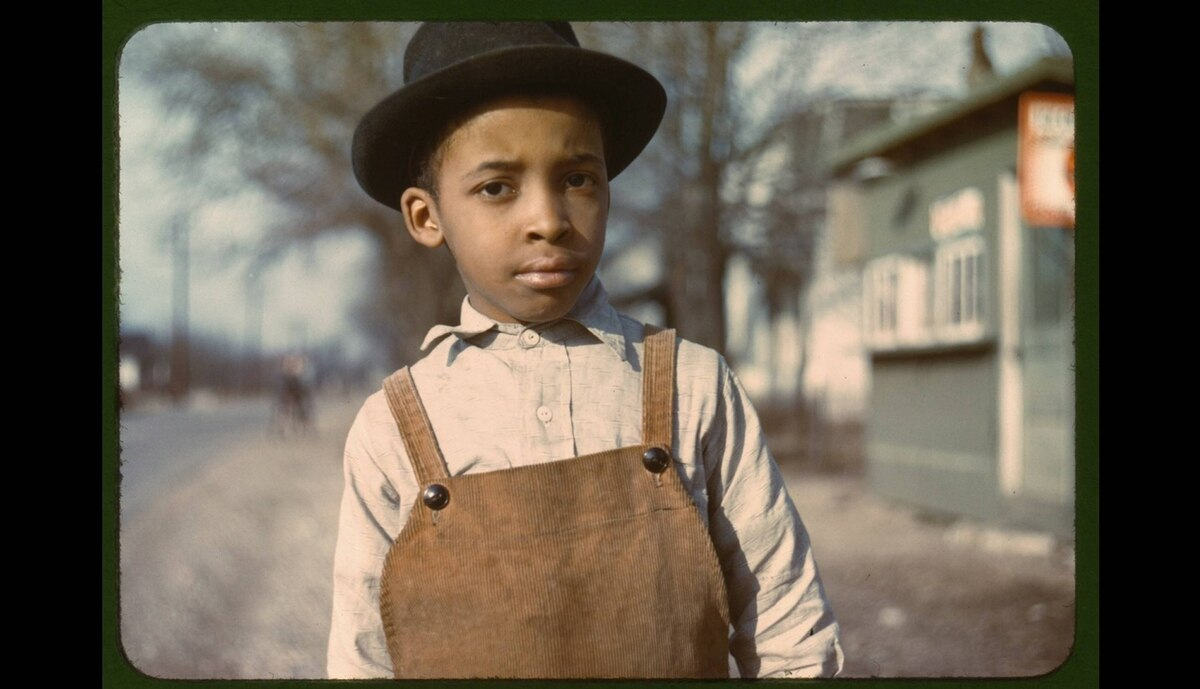 This image entitled Negro Boy shot near Cincinnati, Ohio by John Vachon, between 1939-1943 is part of the US Farm Security Administration photo project. The project was the first to take advantage of Kodak's revolutionary colour film which was officially retired Dec 2010. During its eight-year existence, the section created the 77,000 black-and-white documentary still photographs (also at the Library of Congress) for which it is world-famous. Beginning in 1939, it created 644 color documentary still photographs.