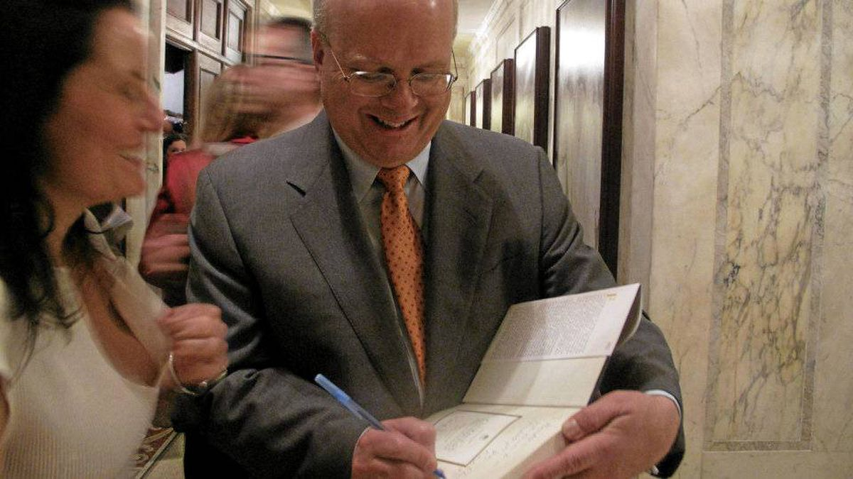 Rove signs a copy of his new book outside the famed Oak Room at the Plaza Hotel where the launch was held.