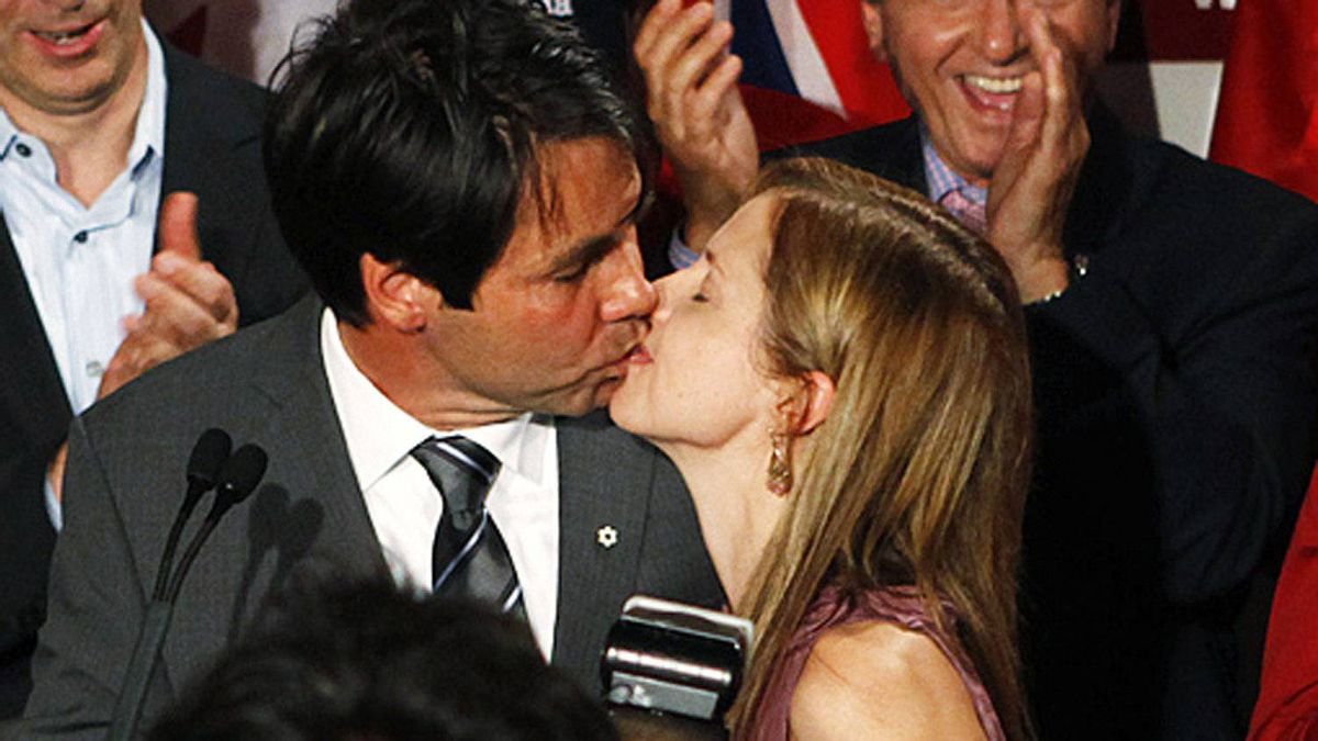 Dr. Eric Hoskins celebrates his win in the St. Paul's riding, kissing his wife. Sept. 17, 2009.