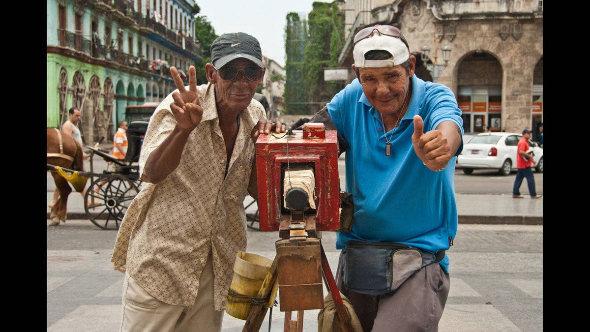 David Zimmerly photo: Pinhole Photographers, Old Town Havana, Cuba - 3 April 2011 - These two entrepreneurs built a version of a pinhole camera to attract tourist customers. Nikon D200, 38mm Nikon 18-200 mm lens), ISO 200, 1/640 at f/5.6.