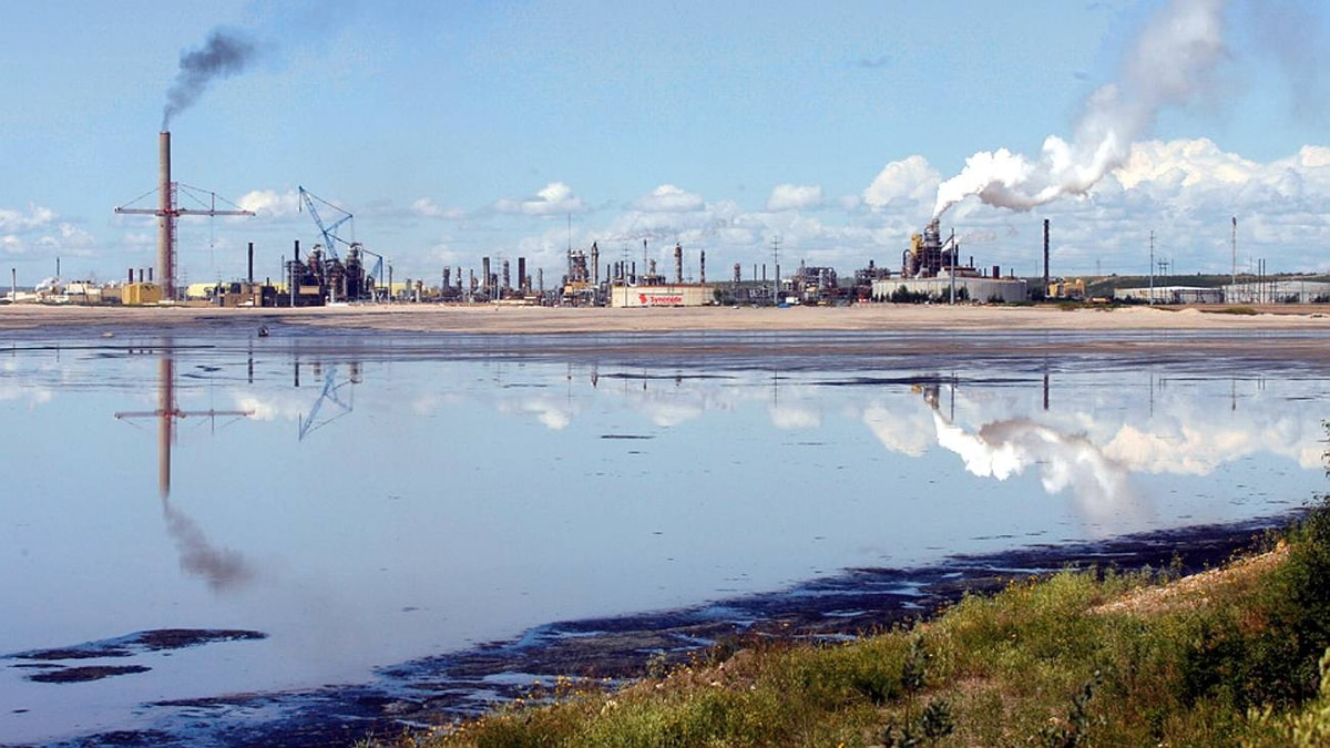 A tailings pond reflects the Syncrude oilsands mine facility near Fort McMurray, Alta.