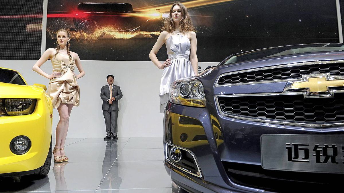 Models pose by the new Chevrolet Camaro coupe (L) and Malibu (R) at the Shanghai Auto Show in Shanghai on April 19, 2011. About 2,000 car and parts makers from 20 countries are participating in the Shanghai auto show, showcasing 75 new car models, 19 of them making their world premieres. AFP PHOTO/Philippe Lopez (Photo credit should read PHILIPPE LOPEZ/AFP/Getty Images)