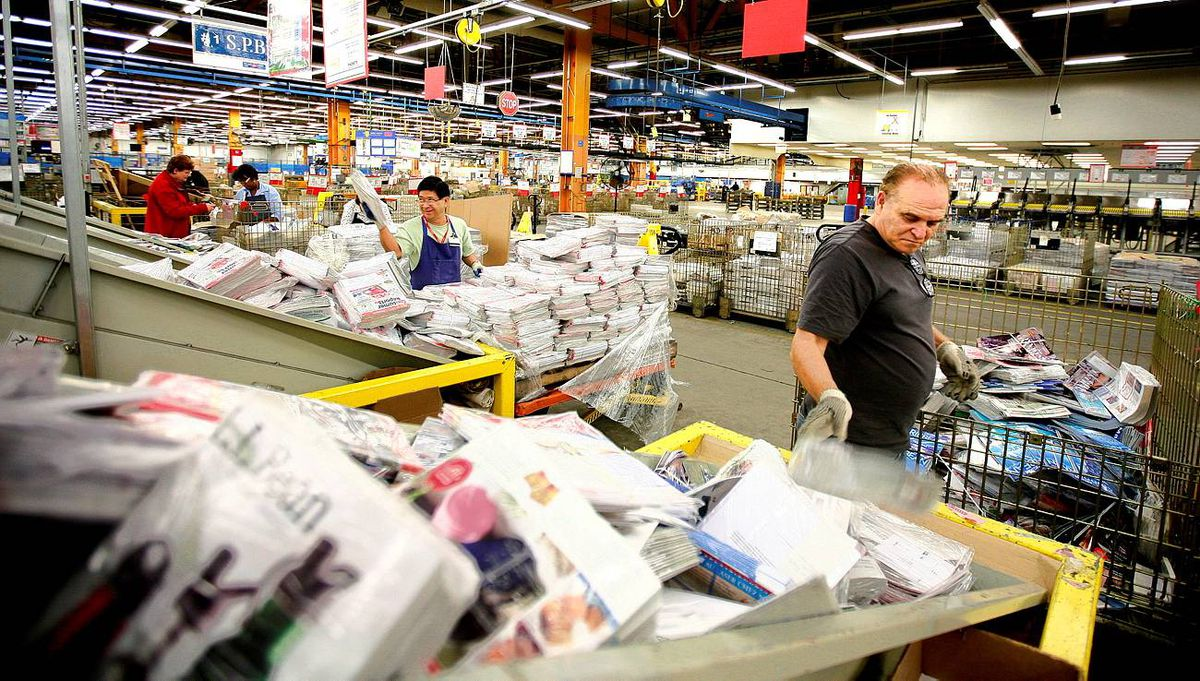 Canada Post worker Demian Luereziamo sorts mail at the Canada Post sorting facility on Dixie Rd. at Eglinton Ave., Mississauga.