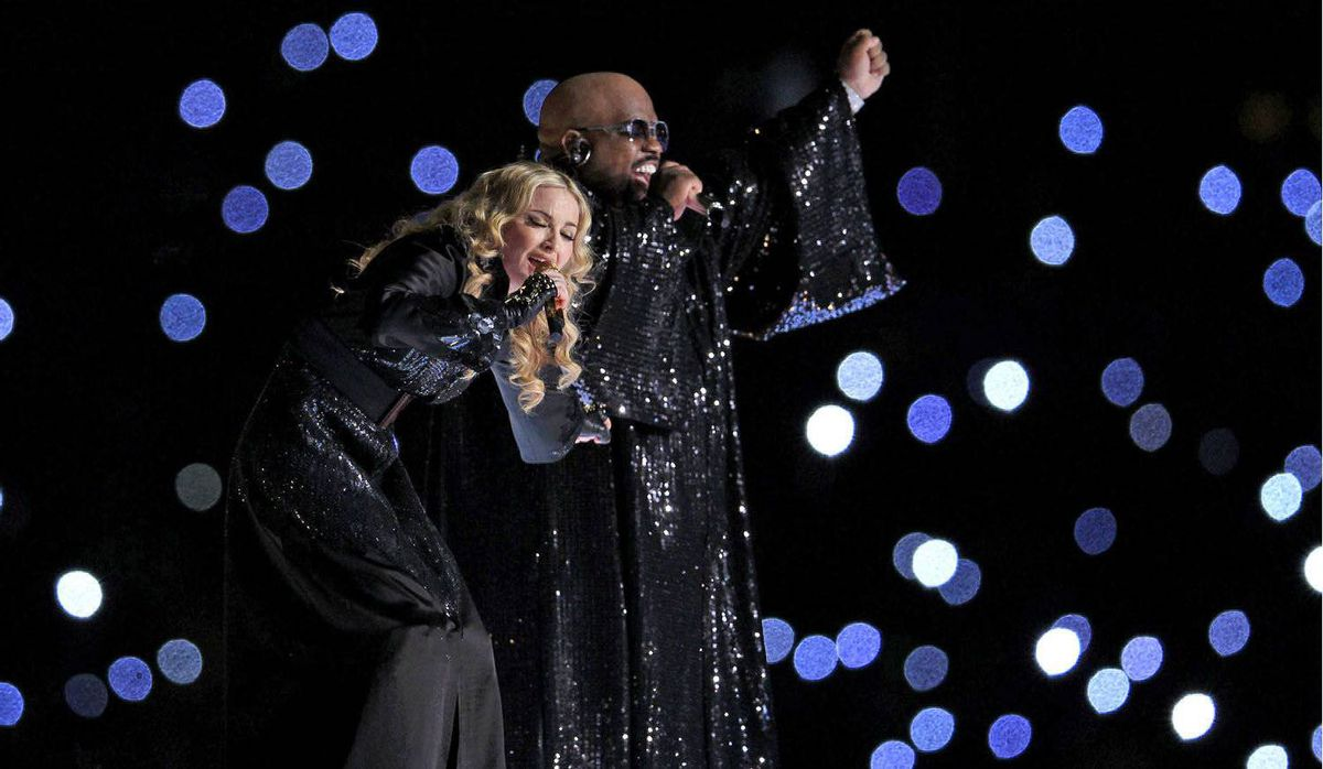 Singer Madonna performs during the halftime show with Cee Lo Green.