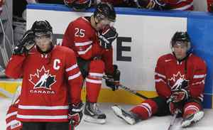 Team Canada defenceman Ryan Ellis (3), forward Ashton Carter (25) and forward Casey Cizikas (right) react after losing 5-3 to Team Russia in the Gold medal game at the IIHF World Junior Hockey Championships in Buffalo, N.Y. on Wednesday January 5, 2011.