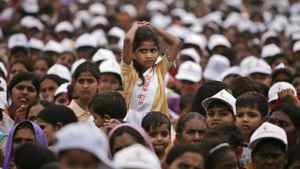 A girl amongst the audience looks on during an event against female feticide organized by Delhi Commission for Women, in New Delhi, India.