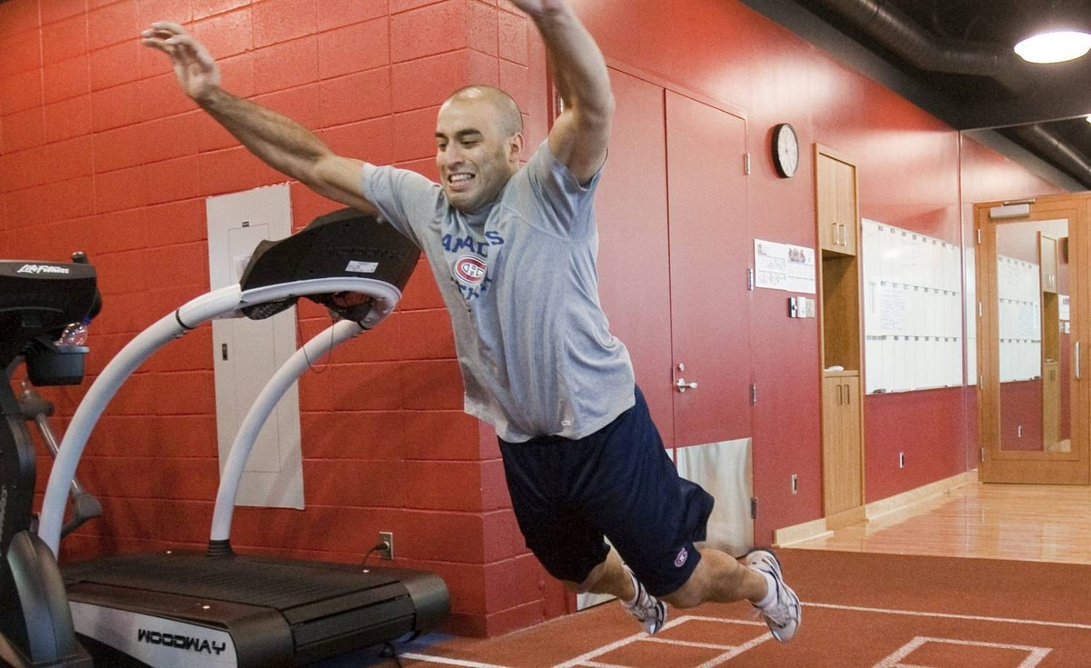 Montreal Canadiens forward Scott Gomez does a standing jump as the players report for medicals on Friday Sept. 17, 2010 in Brossard, Quebec. THE CANADIAN PRESS/Ryan Remiorz