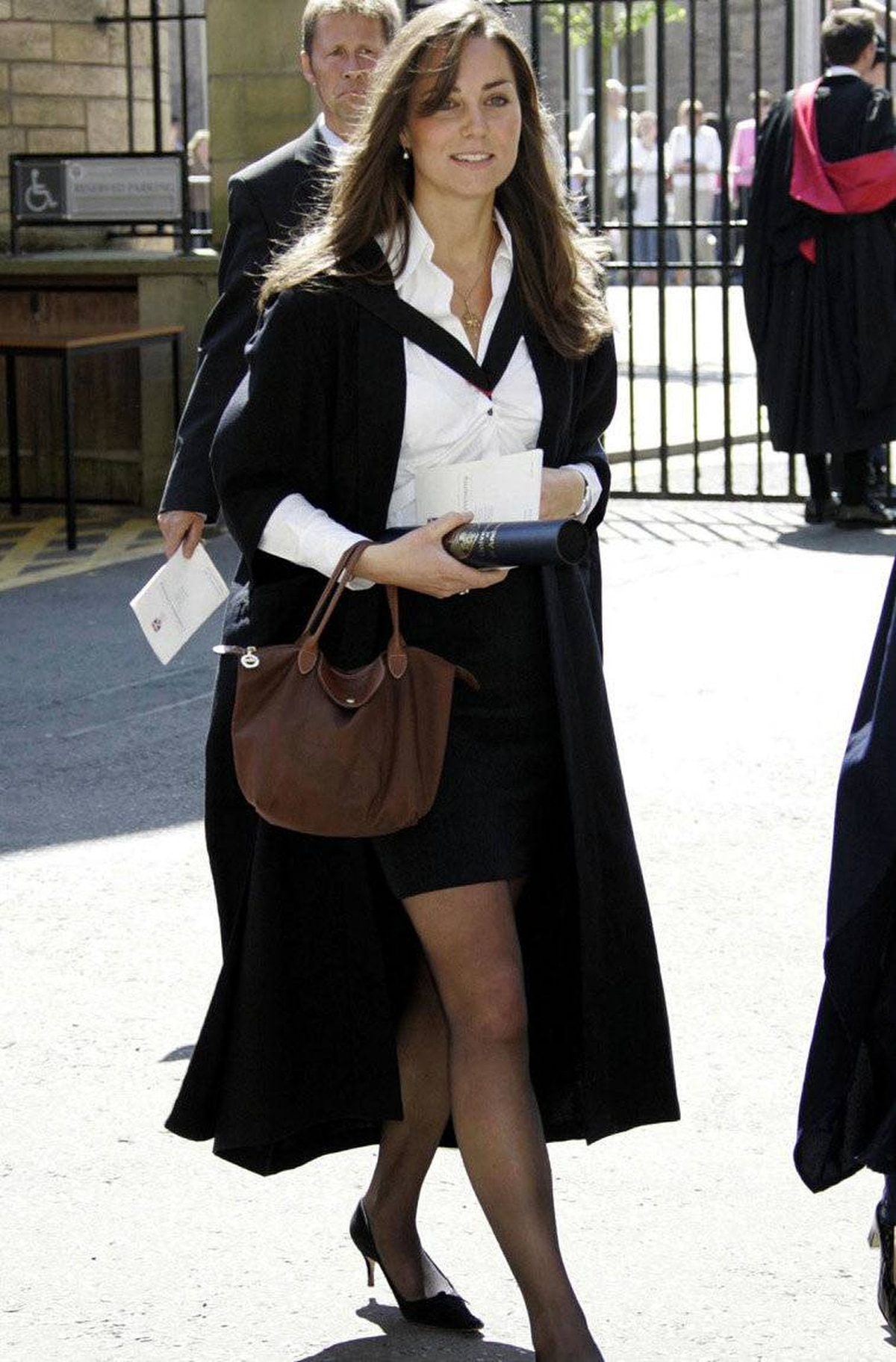 Kate Middleton leaves after attending her university graduation ceremony at St. Andrews University in St. Andrews, Scotland, June 23, 2005. Prince William, received a 2:1 grade for his four-year master of arts degree in geography at the university. Middleton graduated in the same ceremony.
