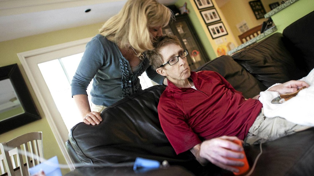 Cancer patient Darcy Doherty, along with his wife Rebecca Cumming, is photographed at his home in Toronto, Ont. Wednesday, May 30/2012.