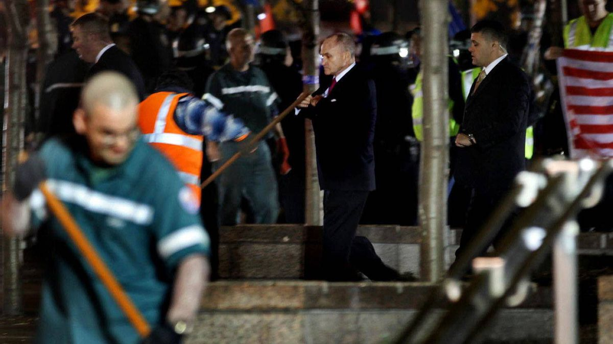 New York City Police Commissioner Raymond Kelly, background centre, walks through Zuccotti Park as Occupy Wall Street protesters are pushed from the area early Nov. 15, 2011.