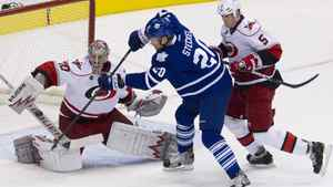 Carolina Hurricanes goaltender Cam Ward saves a shot from Toronto Maple Leafs centre David Steckel at the Air Canada Centre on Dec. 13, 2011.
