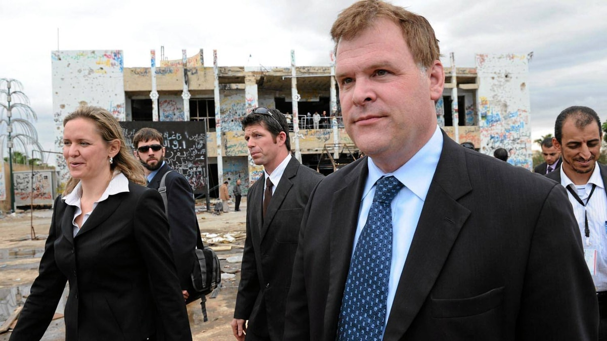 Foreign Affairs Minister John Baird and Canadian ambassador to Libya Sandra McCardell, left, visit the former fortified compound of Moammar Gadhafi in Bab al-Azizya in Tripoli, Libya on Oct. 11, 2011. Sean Kilpatrick/The Canadian Press