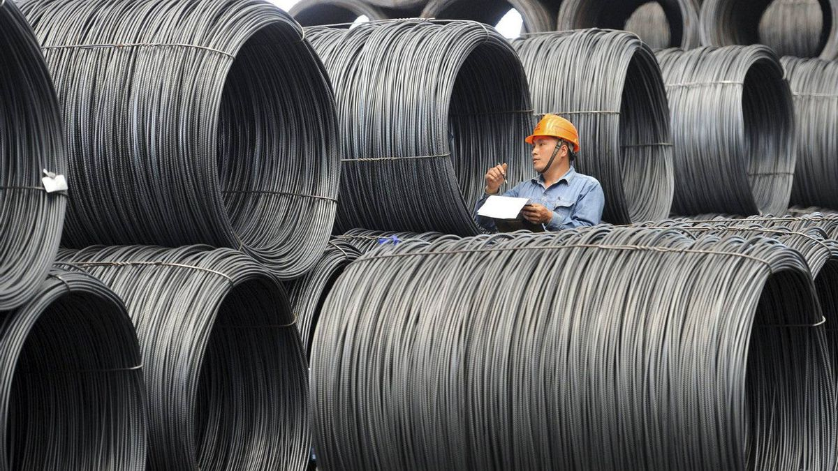 A worker checks stocks of steels at a steel maker in Zhangjiagang in east China's Jiangsu province.