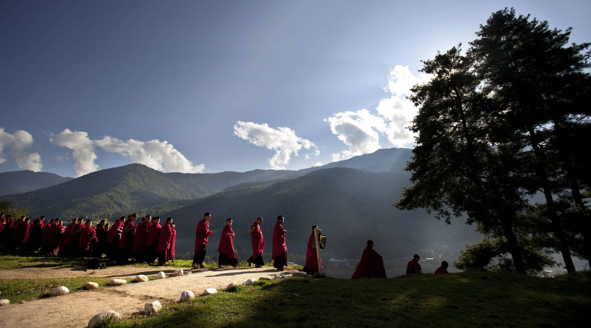 Bhutanese novice Buddhist monks walk to breakfast at a monastery in the capital of Thimphu, Bhutan.