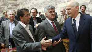 Greek Prime Minister George Papandreou (R) shakes hands with members of Panhellenic Socialist Movement (PASOK) parliamentary group at the parliament in Athens October 31, 2011.