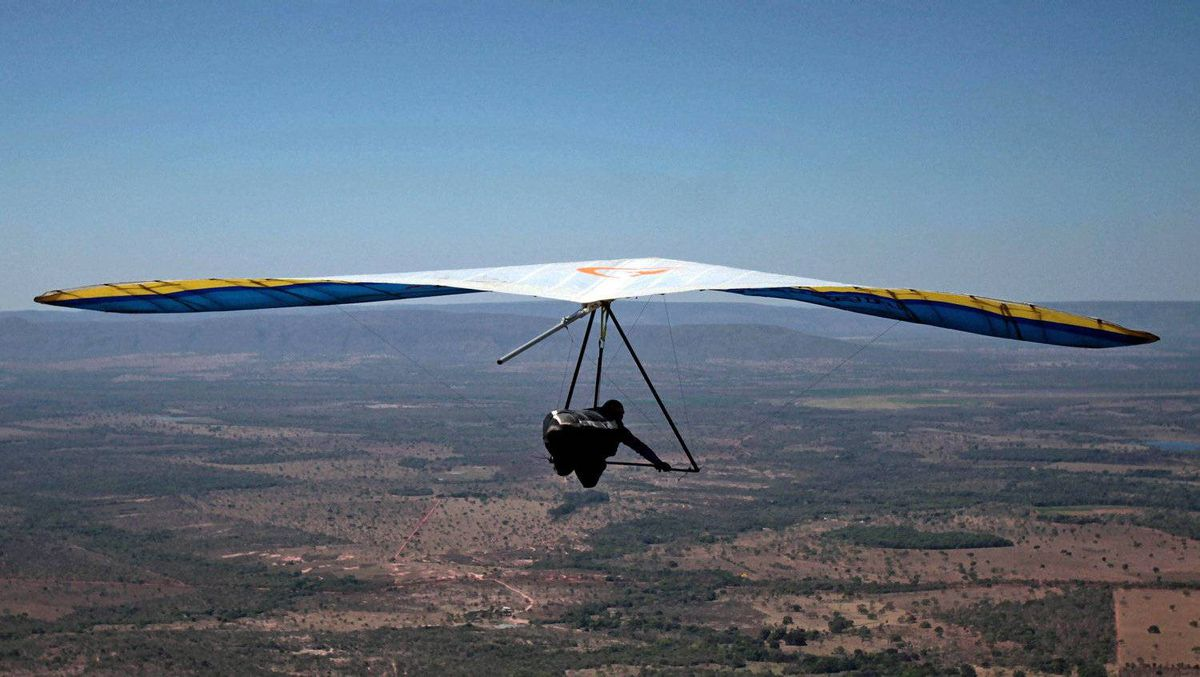 A hang-gliding pilot flies during a competition in Brazil.