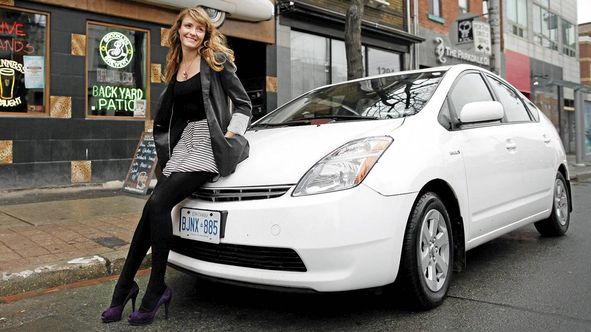 Gemini-award winning actress Helene Joy and her Toyota Prius photographed outside the Cadillac Lounge in Toronto Nov 22, 2010. (Moe Doiron/The Globe and Mail)