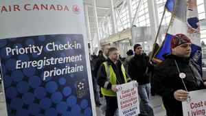 Air Canada employees walk through Terminal 1 during a one hour protest at Pearson International airport in Toronto, March 9, 2012.