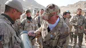 """Hockey Night in Canada star Don Cherry signs heavy artillery during a Christmas Day visit to troops stationed at outposts in Kandahar, Afghanistan, Saturday Dec. 25, 2010. The 76-year-old Cherry worked the mostly French-Canadian troops at each stop with the Kandahar version of his long-running """"Coach's Corner"""" segment that airs during the first intermission of NHL games. THE CANADIAN PRESS/ Steve Rennie"""