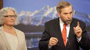 Flanked by Edmonton MP Linda Duncan, NDP Leader Thomas Mulcair holds a news conference at the Alberta Legislature on May 31, 2012.