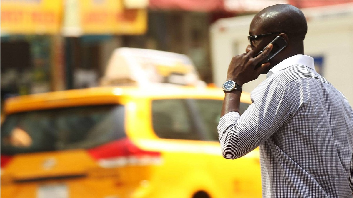 A man speaks on his mobile phone in New York on May 31, 2011.