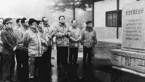 North Korean leader Kim Jong-il, foreground fourth from left, inspects a cenotaph of the signing site of the 1953 truce treaty during his visit to the border village of Panmunjom, between the two Koreas, Nov. 24, 1996.