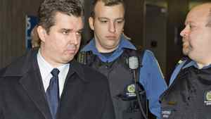 Former Norbourg president Vincent Lacroix is surrounded by special constables as he arrives at the Montreal courthouse on Jan 28, 2008, for sentencing on fraud charges.