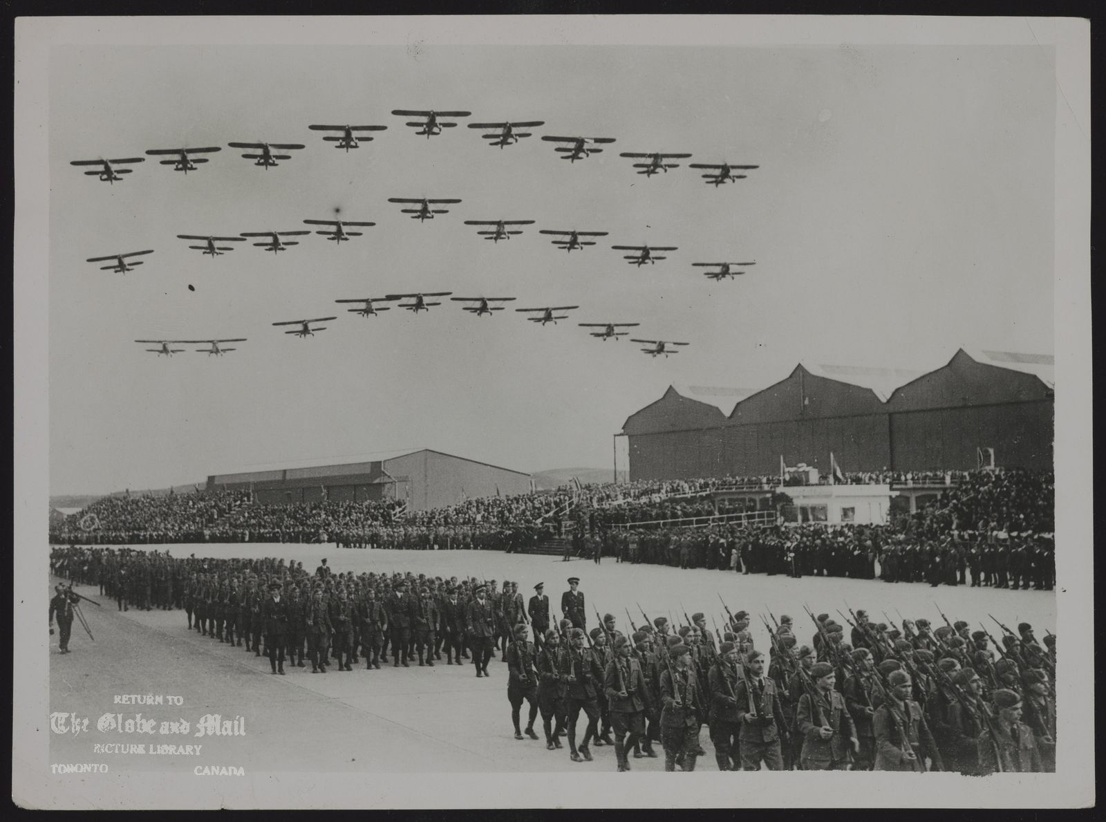 ITALY Air Force MUSSOLINI ATTENDS ITALIAN AIR FORCE ANNIVERSARY CELEBRATIONS. 30.3.36 Mussolini, with General Goamboas, the Hungarian Premier, attended the celebrations on the 13th anniversary of the foundation of the Italian Air Force, at the Littorio Airport, Rome recently. O.P.S. A squadron of bombing planes fly over head in salute as troops on the ground march past Mussollini and General Goamboas, at Littorio Airport. 39/P Keystone