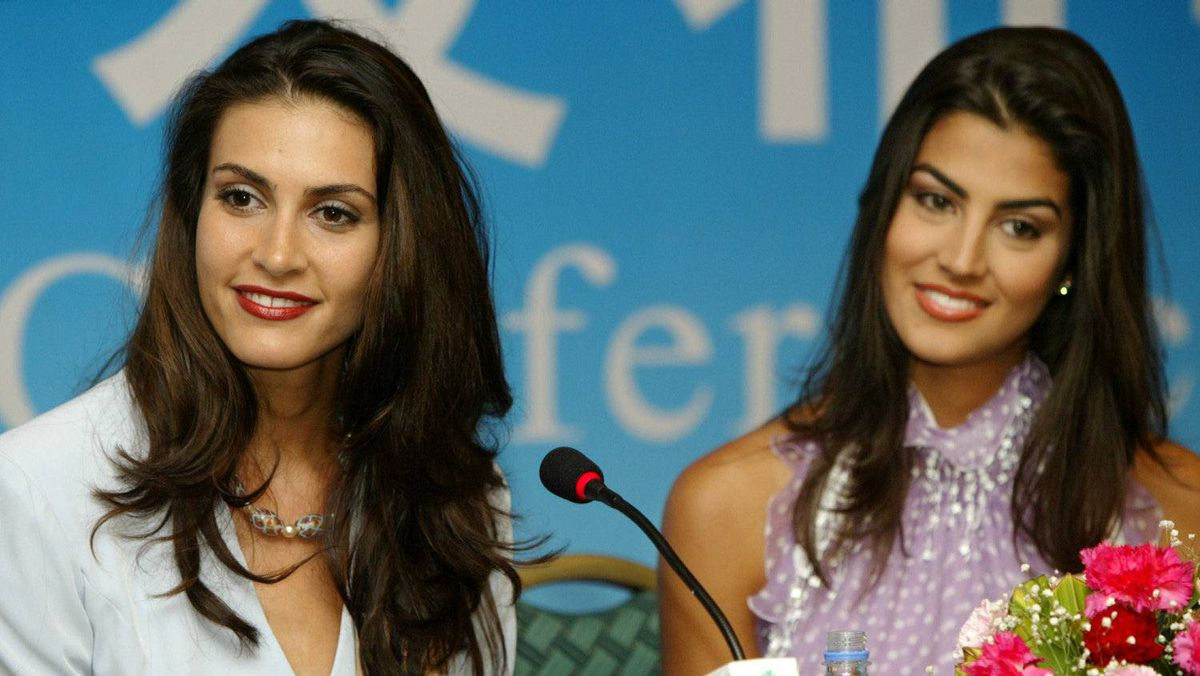 Miss Canada 2003, Nazanin Afghin-Jam, left, takes questions with Miss Venezuela Valentina Patruno Macero at the Miss World finals.