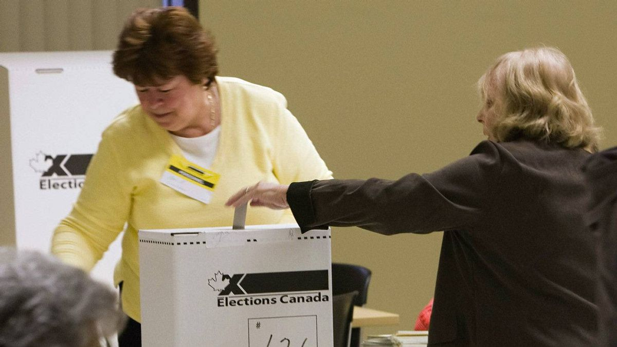 A woman casts her ballot in Canada's federal election in the Quebec City area, Monday, May 2, 2011.