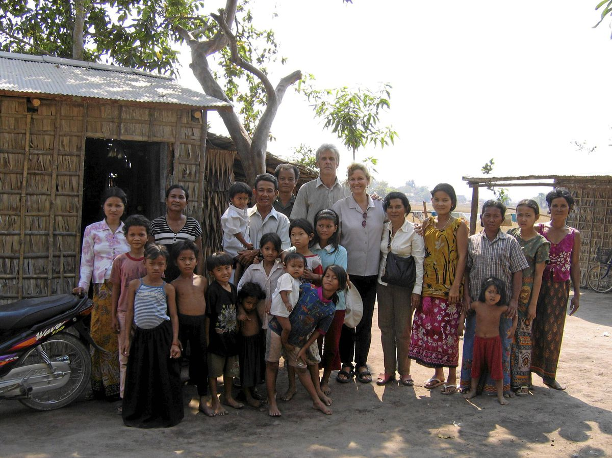 B.C. residents Rick Lennert and Adrianne Dartnall, centre, are devoted to building schools and health centres in Cambodia and other countries.