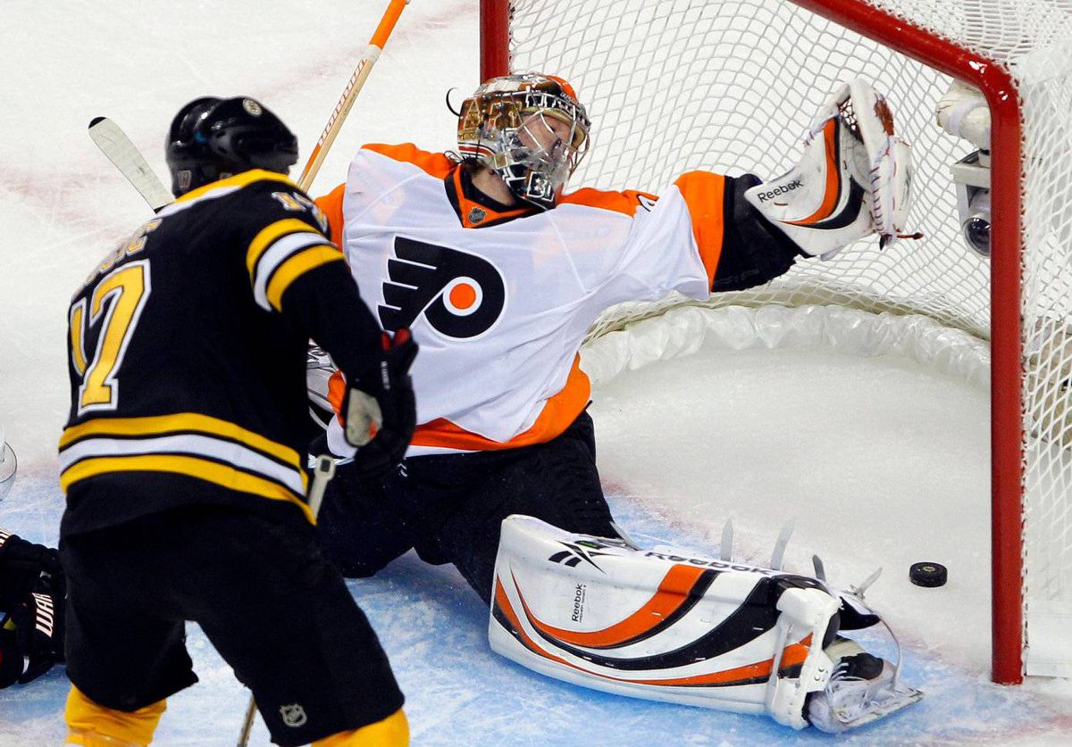 Boston Bruins left wing Milan Lucic (17) scores a power play goal on Philadelphia Flyers goalie Sergei Bobrovsky (35) during the first period in Game 4 of their NHL Eastern Conference semi-final hockey game in Boston, Massachusetts May 6, 2011.