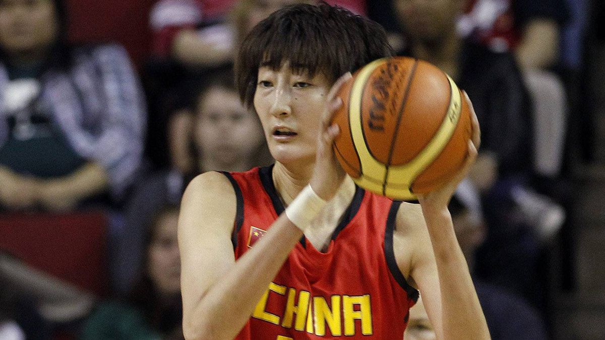 China's Wei Wei (18) looks for room to pass in the first half of an exhibition women's basketball game, Saturday, May 12, 2012, in Seattle.