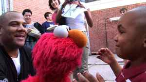 """Kevin Clash (far left) in a scene from """"Being Elmo: A Puppeteer's Story"""": Clash, who grew up in a tough Baltimore neighbourhood, was obsessed with """"Sesame Street"""" and ended up as the creator of one of the most famous of the Muppets' characters."""
