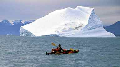 Bruce Kirkby paddles in Scorsbysund, off the east coast of Greenland.