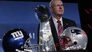 New York Giants head coach Tom Coughlin poses with the Vince Lombardi Trophy after a news conference for NFL football's Super Bowl XLVI Friday, Feb. 3, 2012, in Indianapolis. (AP Photo/Charlie Riedel)