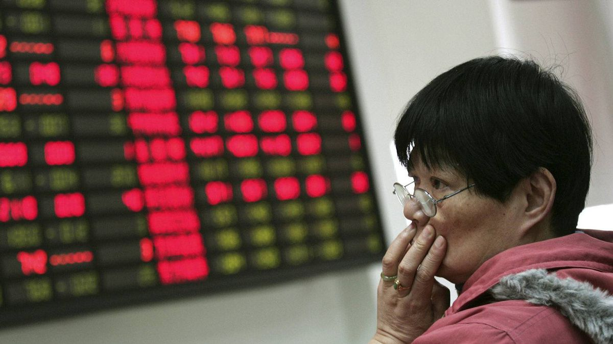 An investor looks at the stock price monitor at a private securities company Thursday, March 22, 2012, in Shanghai, China.