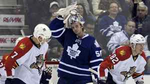 Toronto Maple Leafs goalie Jonas Gustavsson adjusts his mask after allowing a goal to Florida Panthers forward Tomas Kopecky (R) during the second period of their NHL hockey game in Toronto November 8, 2011.