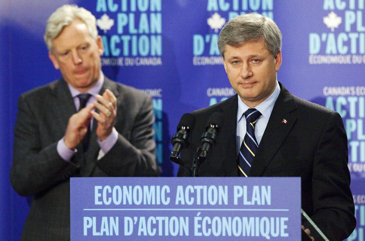 Prime Minister Stephen Harper makes an announcement with Mayor David Miller at the Toronto Reference Library on Oct. 16, 2009.
