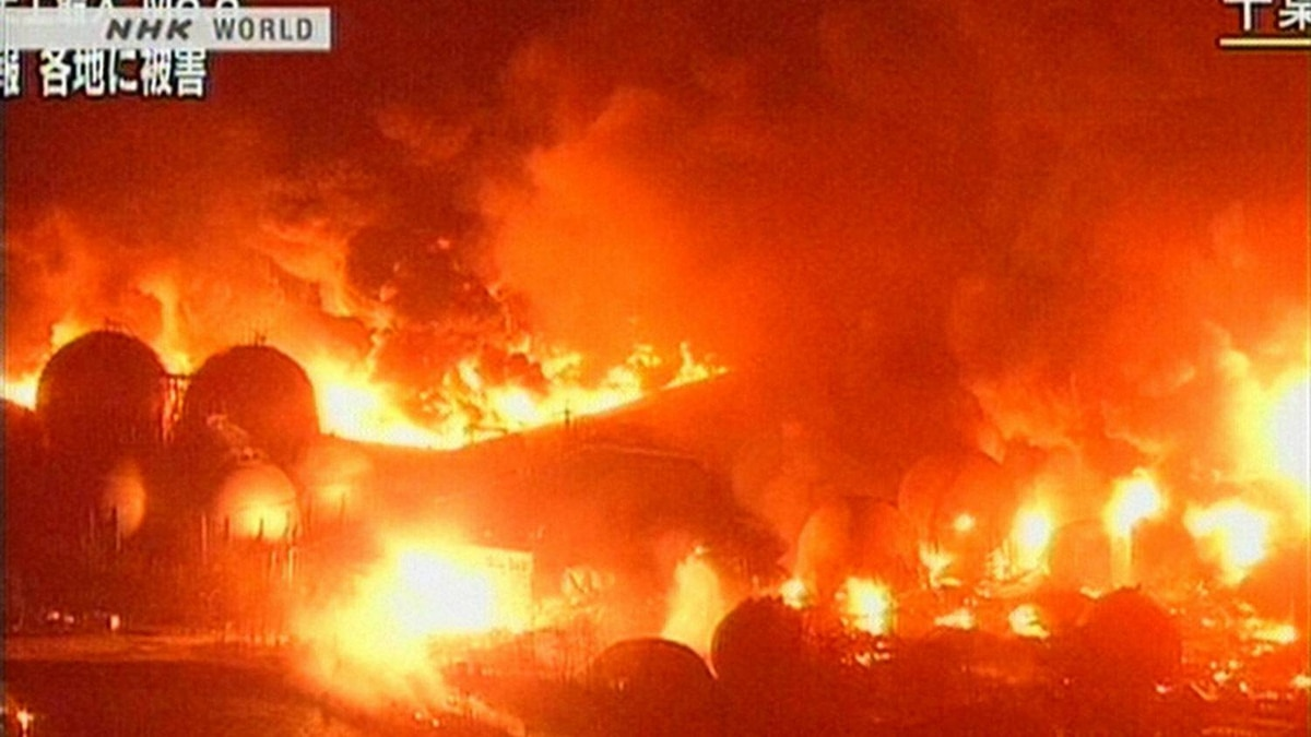 A screen grab taken from news footage by Japanese public broadcaster shows the refinery plant on fire in Ishihara in Chiba prefecture.