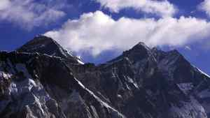Clouds rise behind Mount Everest, the world's highest peak at 8,848 metres.