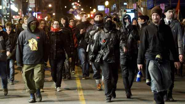 Protesters opposing tuition-fee hikes demonstrate in Montreal on Saturday night.