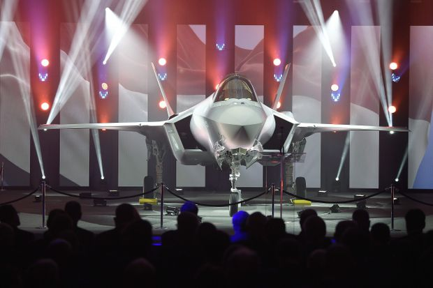 83e0757aac616 Built by Lockheed Martin, the F-35 is a stealth aircraft developed by an  international consortium of allied militaries as part of a deal that  specifically ...