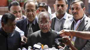 India's Finance Minister Pranab Mukherjee speaks with the media after presenting the 2011-2012 economic survey report, outside the parliament in New Delhi March 15, 2012.